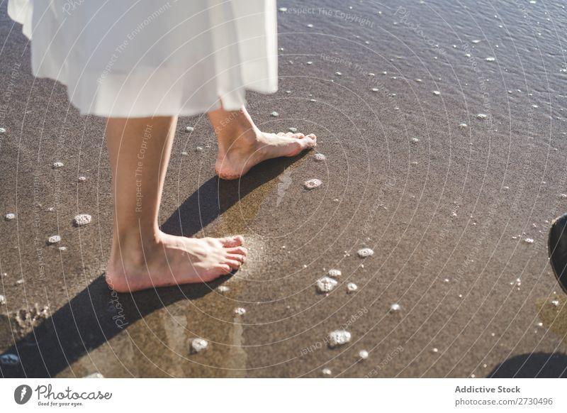 Crop barefoot woman walking on wet sand Woman Bride Barefoot Beach Walking Sand bridal romantic Feet Delicate Leisure and hobbies Ocean Wedding