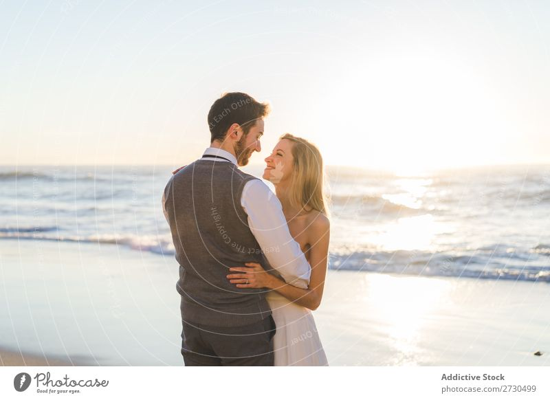 Tender kissing bridal couple in sunlight Couple Wedding Beach Sunlight embracing Engagement Contentment valentine enjoyment in love seascape Stand Relationship