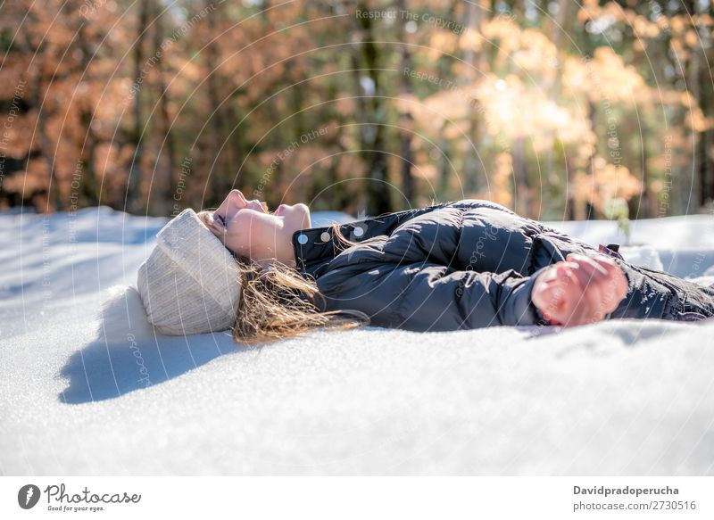 Young cute woman lying playing and enjoying snow in winter Winter Woman Snow Portrait photograph Youth (Young adults) Happy Playing Lie (Untruth)