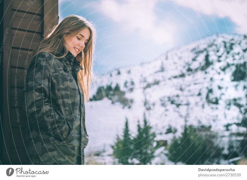 portrait Young pretty woman in winter in a log cabin in the snow Portrait photograph Winter Woman Snow Youth (Young adults) Happy Hut Log Wood Cute Blonde