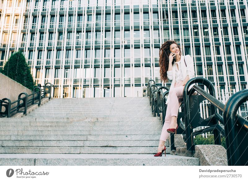 Young redhead business woman walking on the stairs Woman Red-haired Business Businesswoman Technology Work and employment Walking Stairs Suit Pink boss Lady