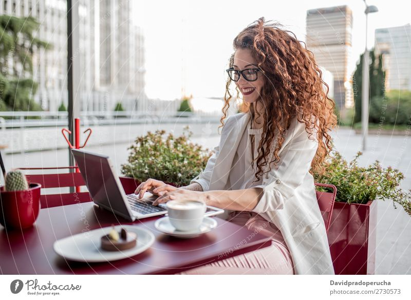 Young business redhead woman on the computer Woman Red-haired Computer Business Technology Work and employment Study Beauty Photography Ginger Curly Summer