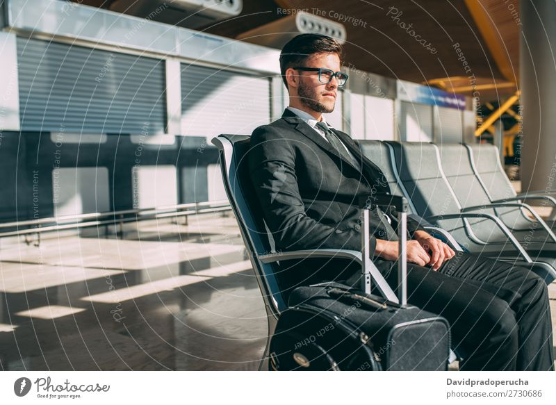 Young business man sitting at the airport waiting for the flight Lifestyle Vacation & Travel Trip Work and employment Business Human being Man Adults Airport
