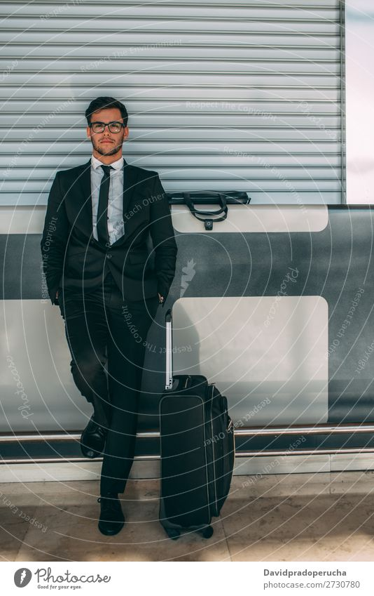 Young business man standing with the suitcase at the airport waiting for the flight Airport Man Vacation & Travel Business Wait Airplane Gate abroad Building