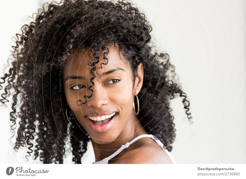 Portrait of a beautiful young black woman looking into camera Woman Portrait photograph Close-up Black Smiling Beautiful Cute