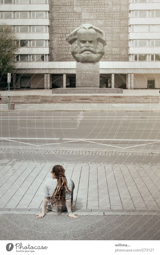 young person on a deserted street in front of a marx monument - youth and politics Youth (Young adults) 1 Human being Chemnitz Town Places Tourist Attraction