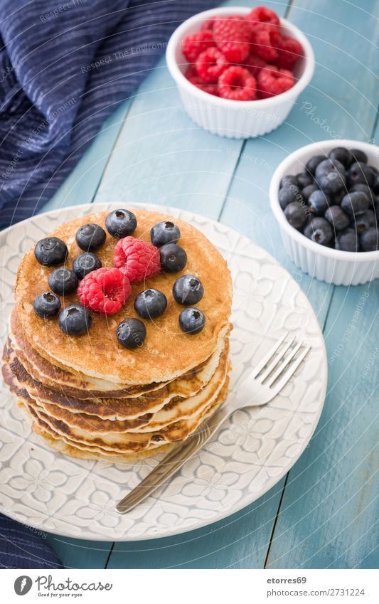 Pancakes with raspberries and blueberries Sweet Dessert Breakfast Blueberry Raspberry Berries Red Baking Food Healthy Eating Food photograph Dish Plate isolated