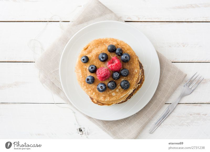 Pancakes with raspberries and blueberries Candy Dessert Breakfast Blueberry Raspberry Berries Red Baking Food Healthy Eating Food photograph Dish Plate