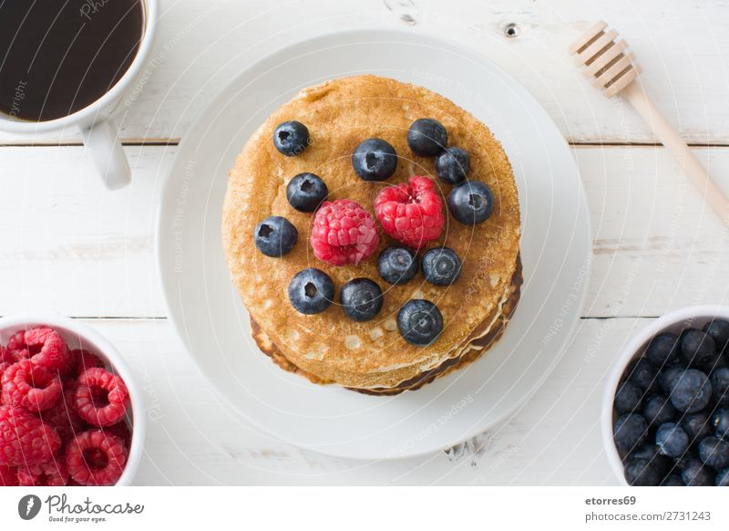 Pancakes with raspberries and blueberries Candy Dessert Breakfast Blueberry Raspberry Berries Red Baking Food Healthy Eating Food photograph Dish Plate isolated