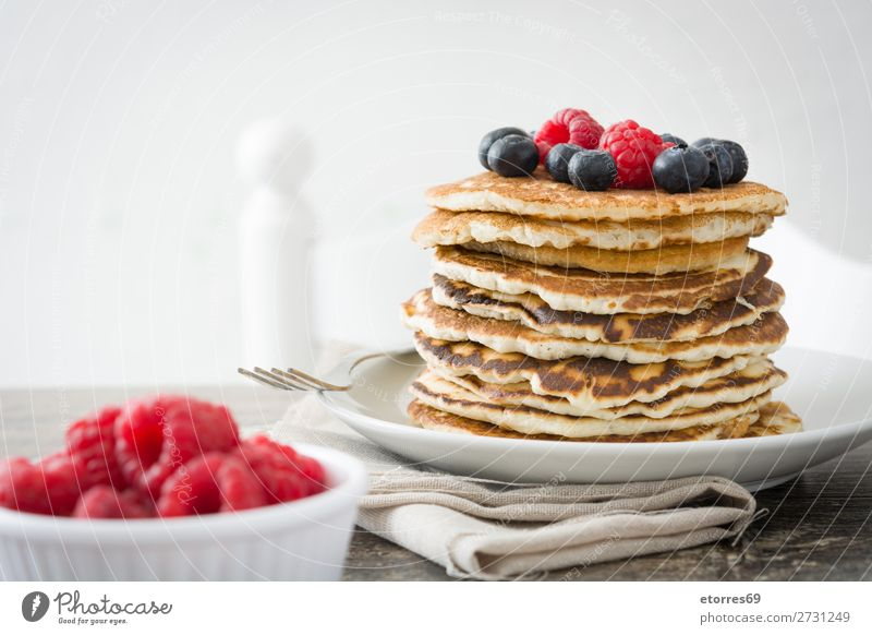 Pancakes with raspberries, blueberries and honey Sweet Dessert Breakfast Blueberry Raspberry Berries Red Baking Honey Food Healthy Eating Food photograph Dish
