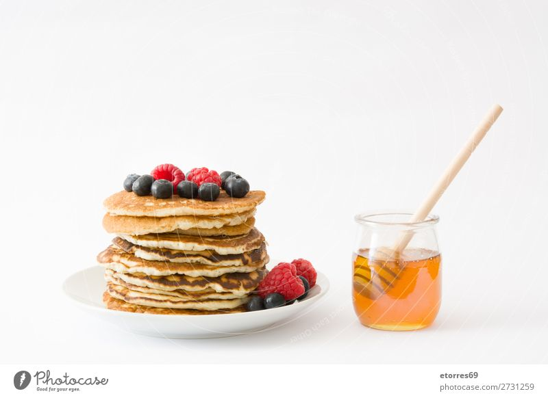 Pancakes with raspberries and blueberries on white Candy Dessert Breakfast Blueberry Raspberry Berries Red Baking Food Healthy Eating Food photograph Dish Plate