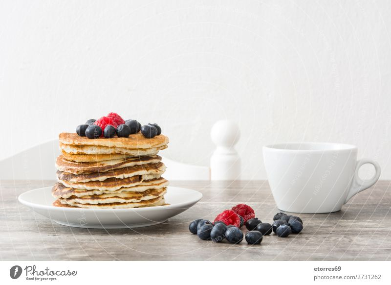 pancakes with raspberries and blueberries on wooden table Pancake Candy Dessert Breakfast Blueberry Raspberry Berries Red Baking Food Healthy Eating