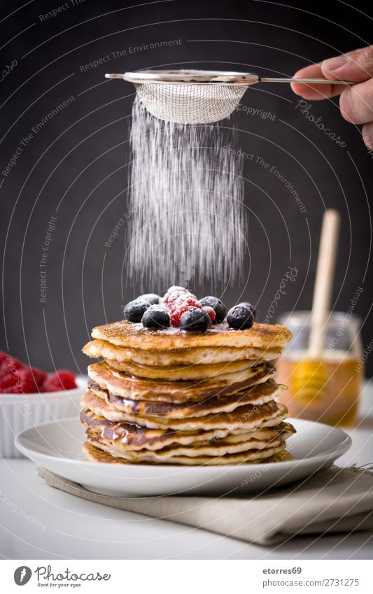 Pouring sugar glass over pancakes Pancake Blueberry Raspberry Dessert Sweet Breakfast Delicious Kitchen decor Plate Food Healthy Eating Food photograph Meal