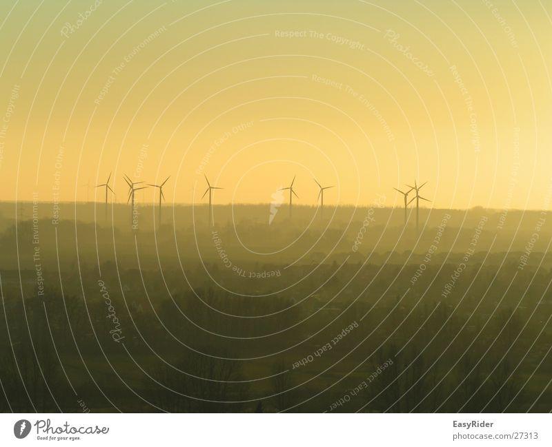 Windmills in the fog Fog Far-off places Wind energy plant windmills