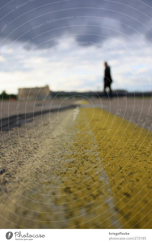 The man on the line Capital city Places Airport Traffic infrastructure Street Airfield Stone Concrete Stand Town Yellow Gray Line Human being Walking