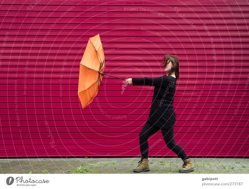 Human being Woman Red Black Adults Feminine Life Wall (building) Autumn Orange Rain Weather Power Wind Energy Crazy
