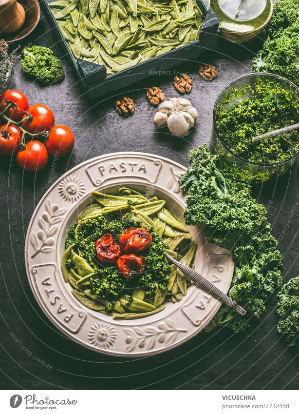 Pasta with kale pesto and grilled tomatoes Food Vegetable Herbs and spices Nutrition Organic produce Vegetarian diet Diet Plate Style Healthy Eating Table
