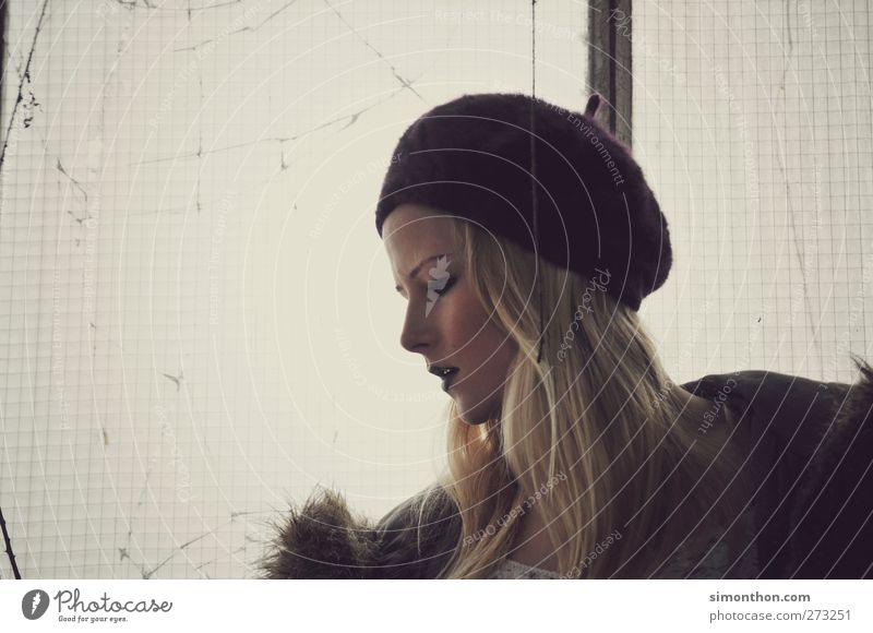 profile 1 Human being Blonde Cold Beautiful Eroticism Feminine Wild Emotions Moody Cap Hair and hairstyles Winter Slice Window View from a window Meditative