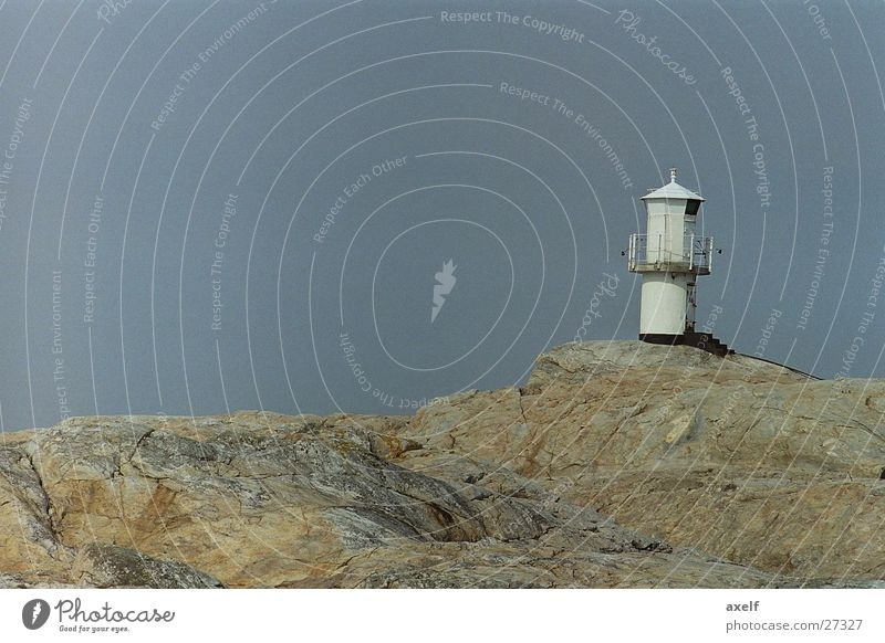 Ocean Loneliness Far-off places Rock Empty Lighthouse
