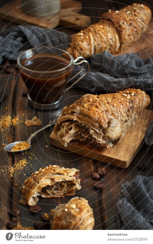 Breakfast with coffee and croissant Bread Croissant Dessert Beverage Espresso Spoon Table Dark Fresh Delicious Brown White Tradition background Bakery caffee