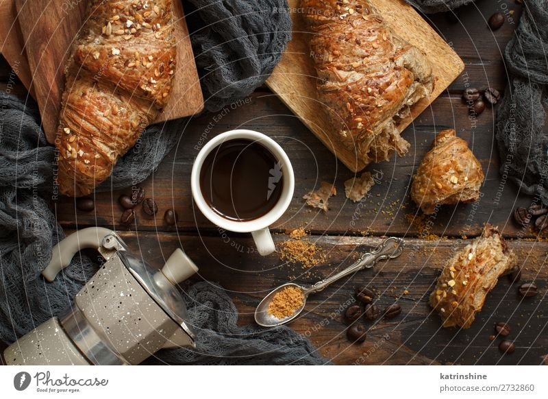 Breakfast with coffee and croissant Bread Croissant Dessert Beverage Coffee Espresso Spoon Table Dark Fresh Delicious Brown Tradition background Bakery Caffeine