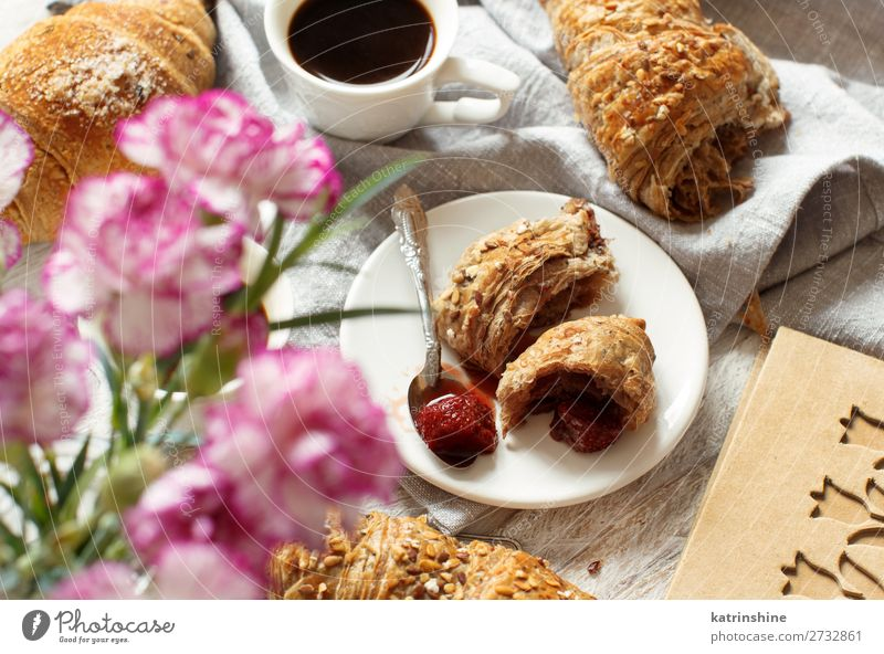 Breakfast with coffee and croissant Bread Croissant Dessert Beverage Espresso Spoon Table Valentine's Day Woman Adults Flower Fresh Delicious Brown White