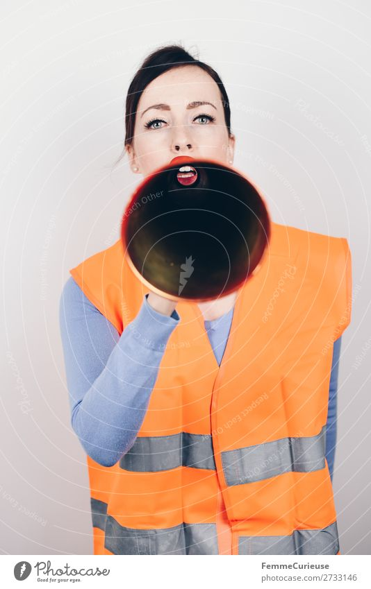 Woman in warning vest making announcement with megaphone Feminine Adults 1 Human being 18 - 30 years Youth (Young adults) 30 - 45 years Communicate Remark Warn