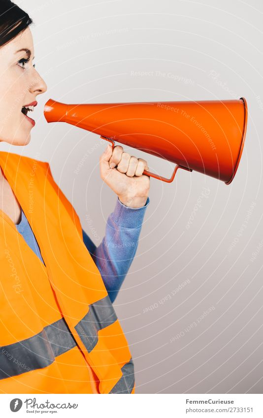 Woman in warning vest making announcement with megaphone Feminine 1 Human being Communicate Respect Warn high-visibility vest Vest Orange Red Megaphone Strike
