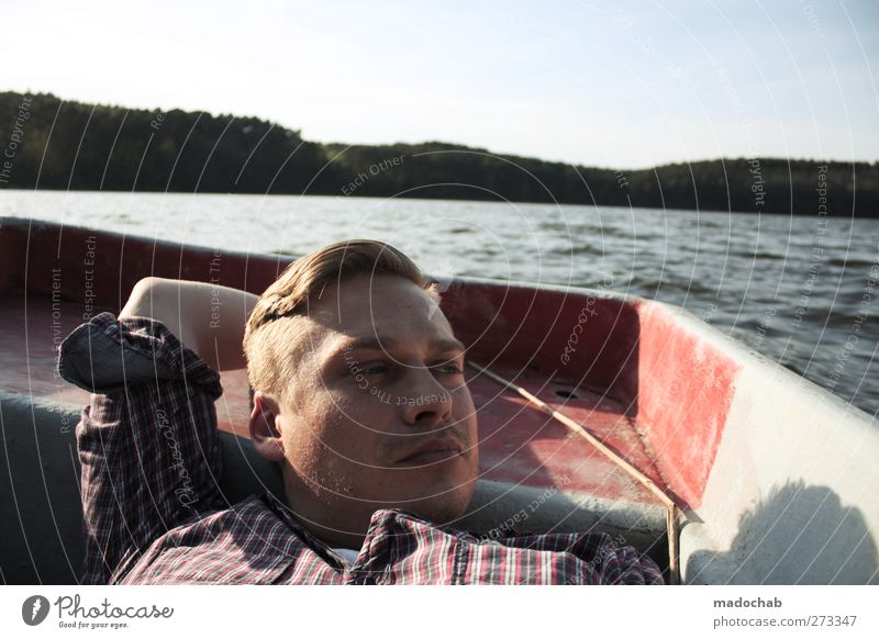 Portrait young man eye contact lying in a rowing boat Lifestyle Wellness Harmonious Well-being Contentment Relaxation Calm Meditation Vacation & Travel Tourism