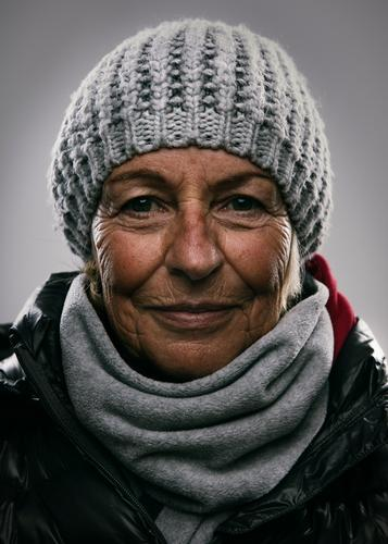Portrait of a lady in a winter outfit Lifestyle Elegant Female senior Woman 60 years and older Senior citizen Winter Fashion Jacket Scarf Cap Smiling Laughter
