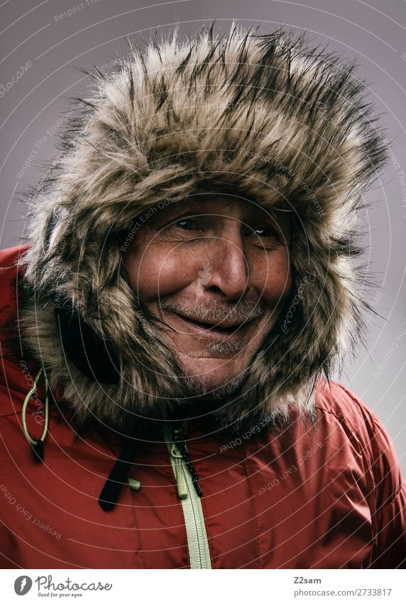 Portrait of a pensioner in a winter outfit Lifestyle Male senior Man 60 years and older Senior citizen Winter Fashion Jacket outdoor clothing Cap Smiling