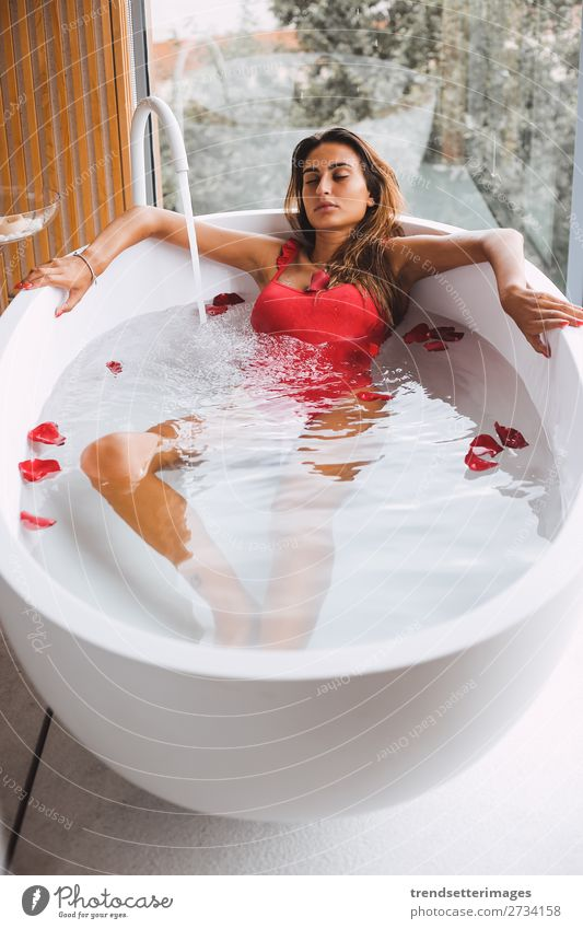 Woman in a modern bath tub Lifestyle Luxury Beautiful Body Skin Wellness Relaxation Spa Bathtub Bathroom Adults Flower To enjoy Modern Clean young girl Tub care