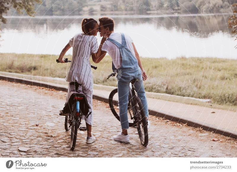 Romantic couple riding bicycles Lifestyle Joy Happy Beautiful Leisure and hobbies Woman Adults Man Family & Relations Couple Nature Landscape Autumn Street