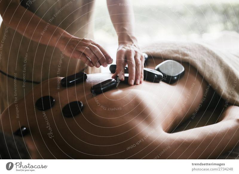 Man enjoying a back massage Lifestyle Luxury Beautiful Body Skin Medical treatment Wellness Relaxation Spa Massage Leisure and hobbies Woman Adults Couple Hand