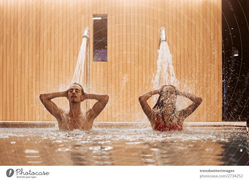 Couple In Love At Luxury Hotel Lifestyle Joy Happy Beautiful Wellness Relaxation Spa Swimming pool Leisure and hobbies Woman Adults Man Waterfall Smiling water