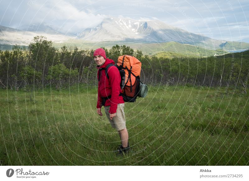 Young man with hiking backpack in nordic island landscape Vacation & Travel Mountain Hiking Human being Youth (Young adults) Norway Backpacking vacation Wild