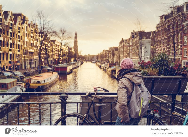 Woman looking at sunset at one of the canals in Amsterdam Vacation & Travel Tourism Trip Sightseeing City trip Feminine Young woman Youth (Young adults) 1