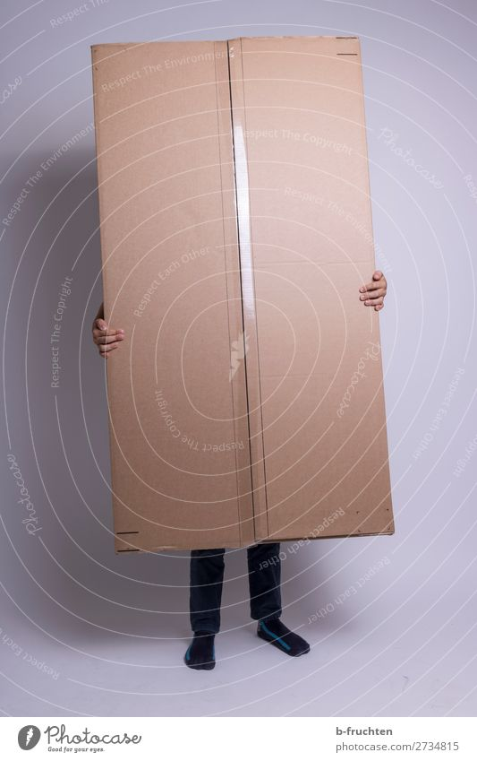 Person with large package Hand Fingers Legs 1 Human being Packaging Container Touch To hold on Stand Hide Cardboard Package parcel service Colour photo
