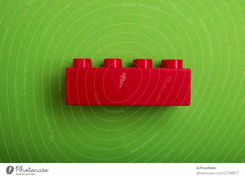 red building block on green background Joy Playing House (Residential Structure) House building Redecorate Toys Plastic Select Utilize Observe Make Green