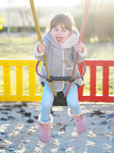Child swinging Human being Nature Plant Sun Winter Girl Lifestyle Autumn Feminine Laughter Freedom Fashion Park Field Happiness