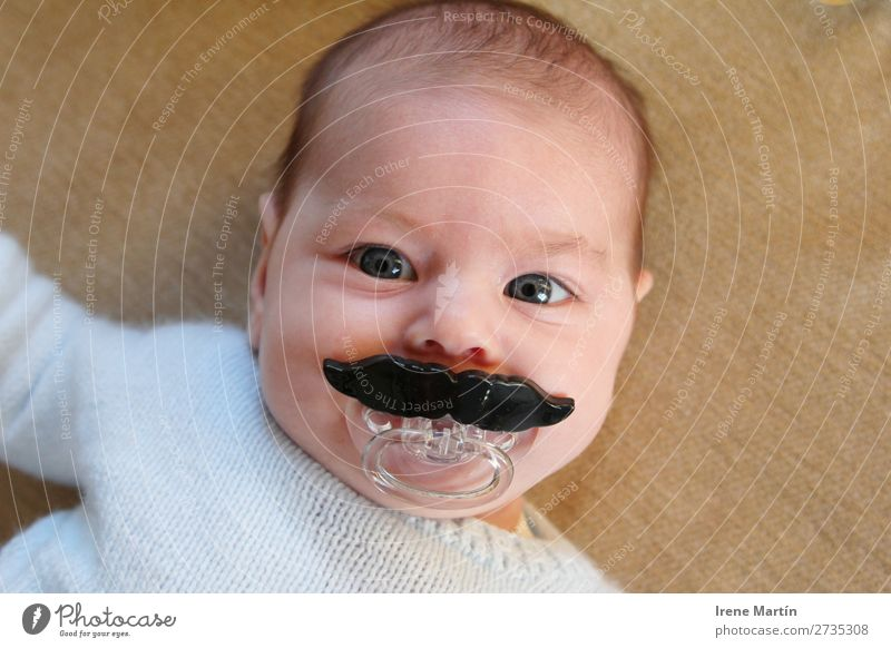 Baby with a big moustache Parenting Human being Feminine Child Toddler Girl Infancy Face Eyes 1 0 - 12 months Short-haired Moustache Toys Observe Looking Blonde