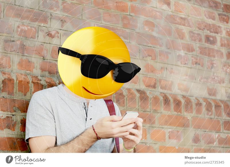 Emoji head man Lifestyle Style Happy Business To talk Telephone PDA Technology Internet Human being Boy (child) Man Adults Smiling Sit Stand