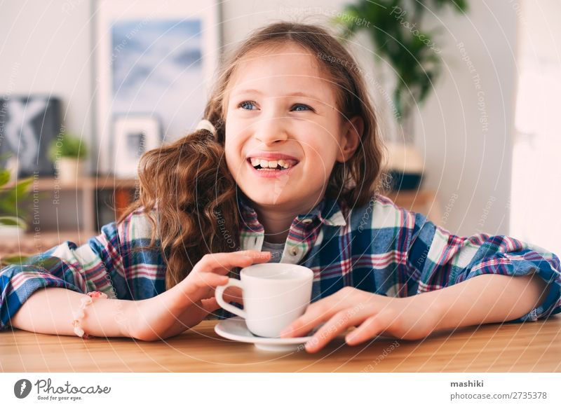 happy kid girl drinking tea for breakfast. Child Human being Relaxation Lifestyle Warmth Funny Happy Playing Infancy To enjoy Kitchen Breakfast Hot Home Tea