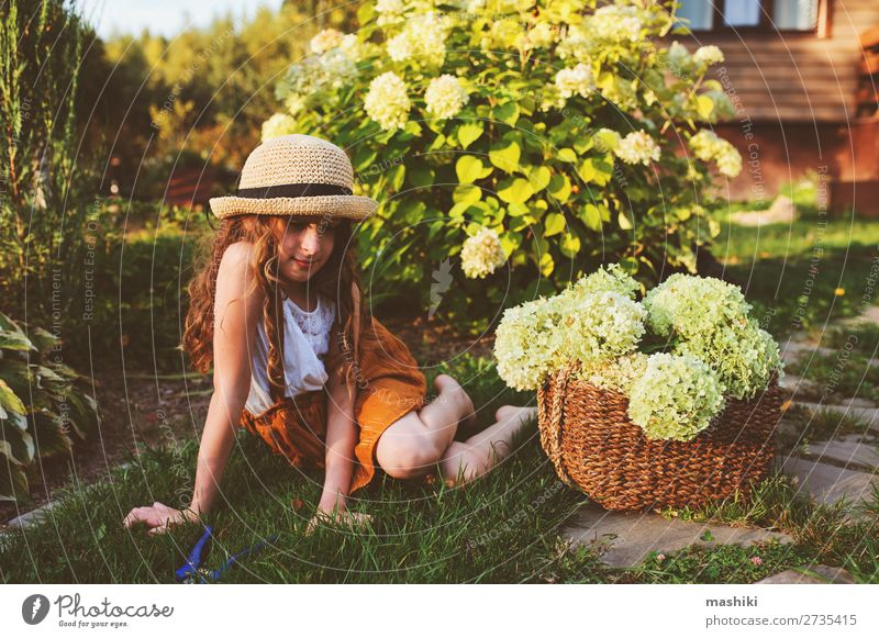 happy romantic kid girl playing and picking flowers Lifestyle Joy Harmonious Leisure and hobbies Summer Garden Child Gardening Environment Nature Landscape