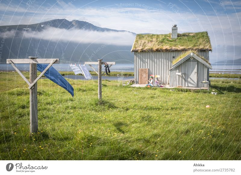 Old fishing hut in Norway 1 Human being Nature Clouds Grass Mountain Coast Fjord Dream house Hut Clothesline Fantastic Fresh Beautiful Wild Blue Green Happy