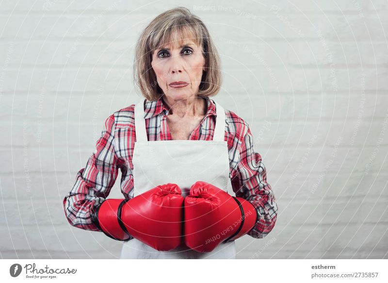 sad senior woman with boxing gloves Lifestyle Retirement Human being Feminine Female senior Woman Grandmother 1 60 years and older Senior citizen Old Fitness