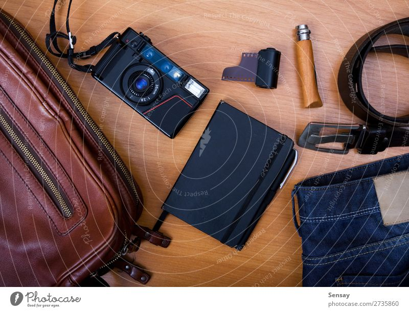 Set of cool accessories Style Trip Business Meeting Camera Book Tree Jeans Paper Pen Metal Old Blue Brown White Diary Notebook Open Lined Paper Spiral Page