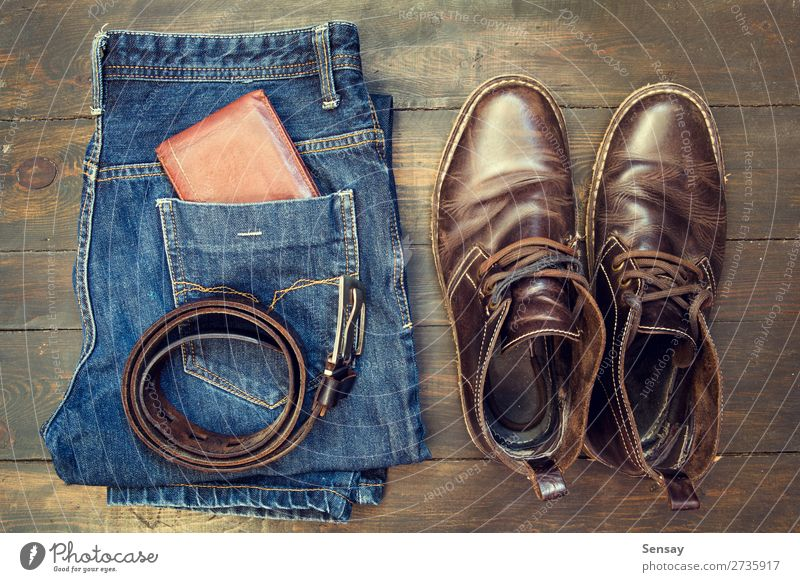 Jeans, belt , shoes and wallet on wooden background Style Design Vacation & Travel Business Man Adults Fashion Clothing Pants Leather Accessory Footwear Boots