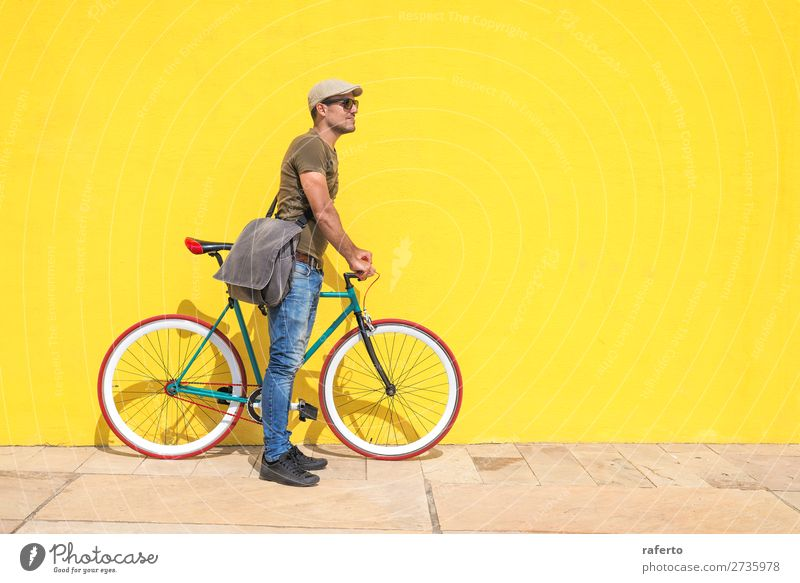 Side view of a young hipster man with a fixed bike Human being Masculine Young man Youth (Young adults) Man Adults 1 13 - 18 years 18 - 30 years Clothing