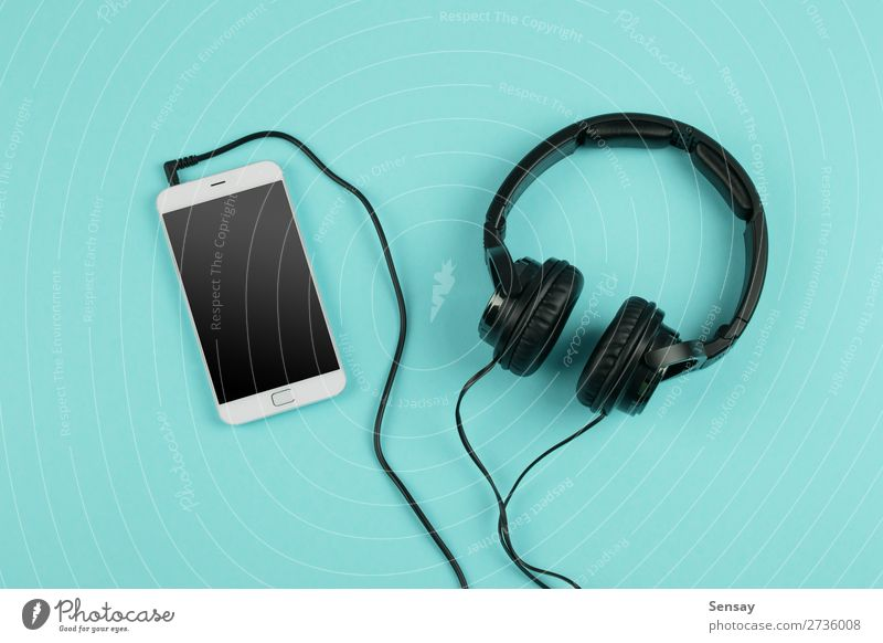 Music online concept - phablet and headphones Leisure and hobbies Table Business Telephone PDA Computer Screen Technology Internet Media Above Smart Blue White